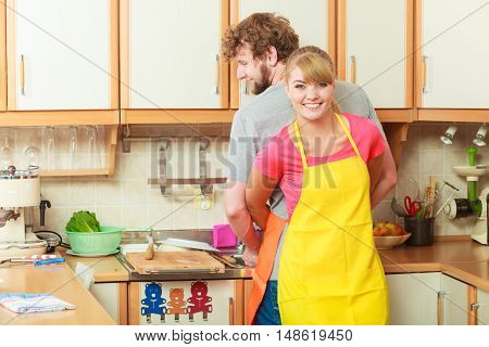People housework and housekeeping concept. Couple doing the washing up together in kitchen interior