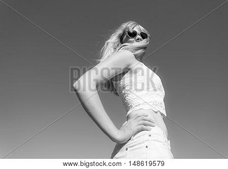 Girl In Sunglasses Relaxing Outdoor Against Sky