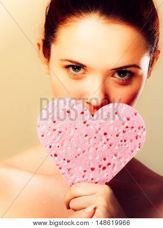 Woman Holding Pink Heart Sponge In Hands.