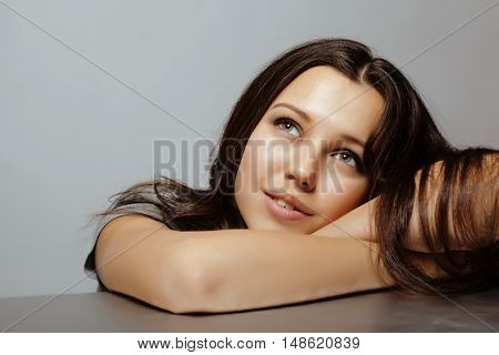 beauty young teenage brunette real girl happy dreaming smiling close up on grey background, lifestyle people concept