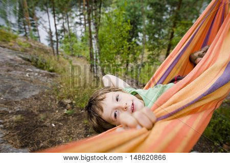little cute boy in hammock happy smiling, forest relax, lifestyle people concept close up