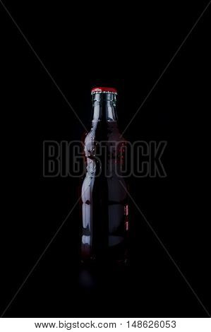 Bottles With Red Drink On Black Background.