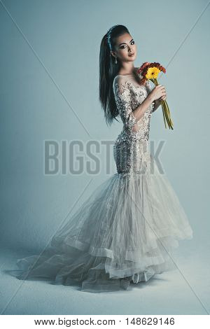 Young asian woman in dress with flowers fashion portrait