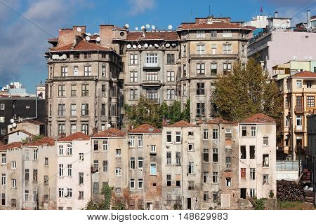View of old houses and tiled roofs of Istanbul in the Beyoglu district. Next to the famous Taksim Square.