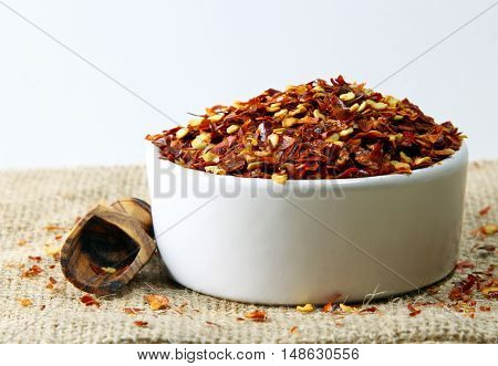 Crushed red pepper in a bowl with shallow depth of field