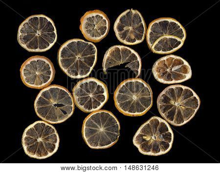 Sun-dried (dried) lemon close up on a black background