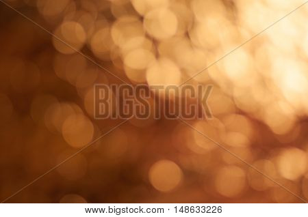 Circle bokeh with  bronze color background , glitter magic background