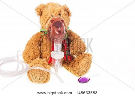 teddy bear sick in inhaler mask on white backgroud