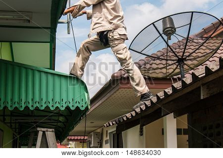 young man working install antenna , intall