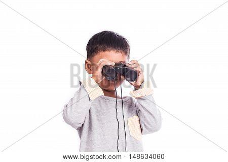 little boy looking through binocular on background