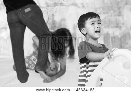 family fight concept boy crying with his parent fighting