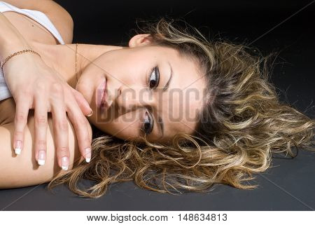 Young glamour beautiful woman lies on a floor
