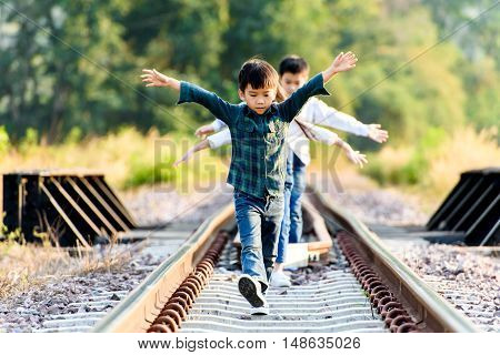 Boy And Girl Walk On The Railway