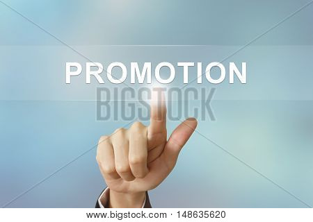 business hand pushing promotion button on blurred background