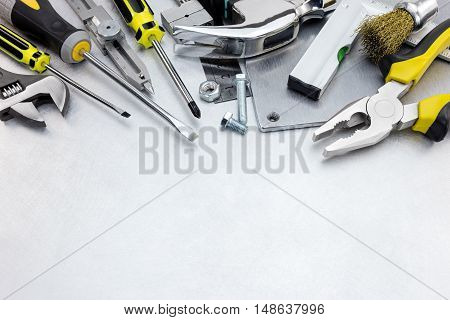 Scratched Metal Background With Yellow Tool Set And Instruments For Hand Work