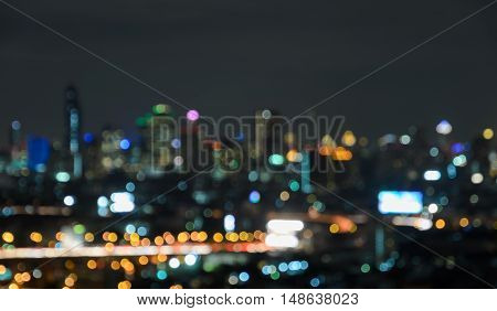 Colorful blurred skyscrapers with city bokeh lights illuminated at twilight