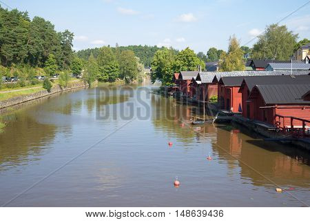 PORVOO, FINLAND - AUGUST 20, 2016: Sunny august day on the Porvoyoki river. Historical landmark of the city Porvoo, Finland