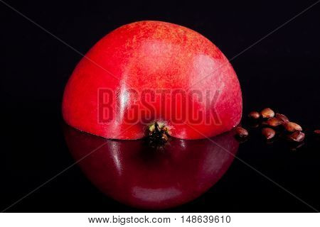 half of red apple with reflection isolated on black background