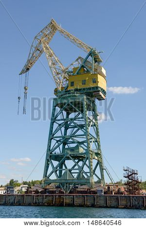 Powerful Crane Is In Southern Bay Seaport, Sevastopol, Crimea, Russia.