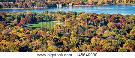 Panoramic aerial view of Central Park, Jacqueline Kennedy Onassis Reservoir and the Great Lawn with colorful Fall foliage. New York City.