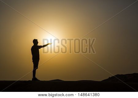 man holding a sun on his hand