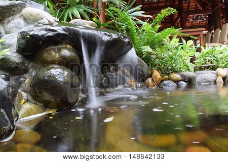 rocky fountain stream landscaping in zen garden