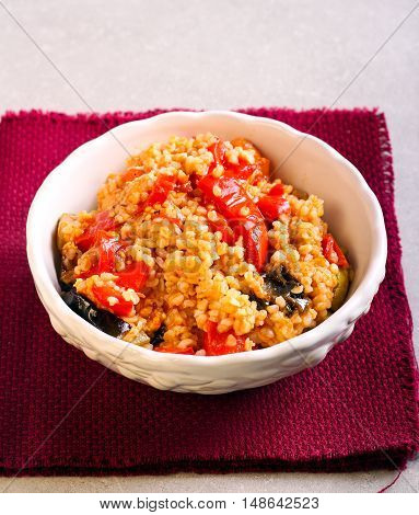 Bulgur with sauteed vegetables in a bowl