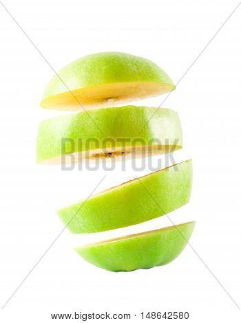 Green apple sliced over white background, studio