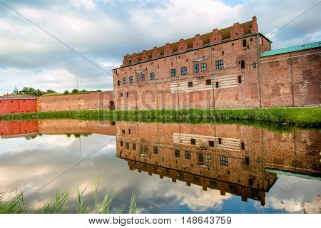 Castle Malmohus in Sweden with a beautiful reflection in the water