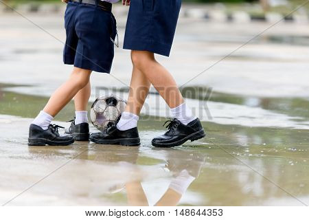 Boys In Black Shoe Play Football