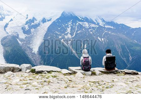 Two Japanese Tourist Look At Mont Blanc