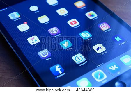 Moscow Russia - September 16 2016: social media network and over programs known brands on the screen iPad from Apple.