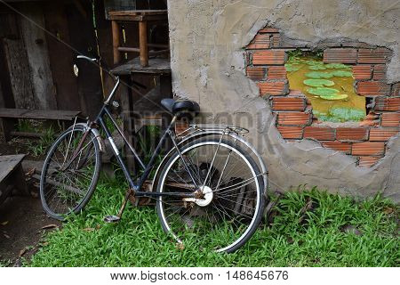 bike and the cracked brick wall background