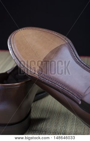 Footwear Concepts. Backside View of Penny Loafer Natural Leather Sole. Vertical Image