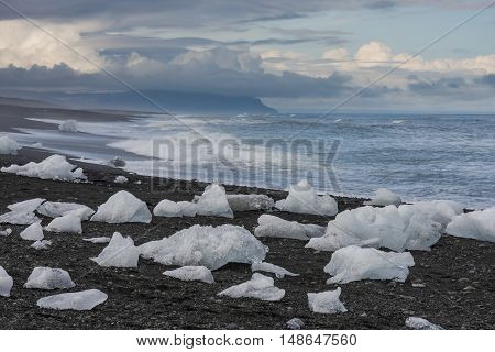 Ice blocks at the beach in the evening near river Jokulsa at Jokulsarlon glacier lagoon in the Vatnajokull National Park Iceland.