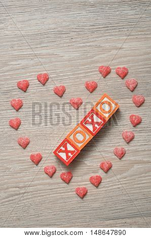 Valentine's Day. XOXO Spelled with colorful alphabet blocks with a candy heart