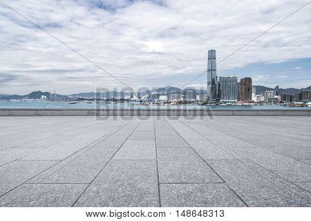 modern office buildings in hong kong from empty brick floor