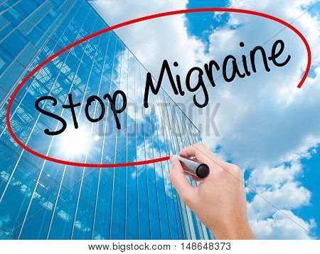Man Hand Writing Stop Migraine  With Black Marker On Visual Screen