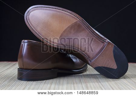 Footwear Concepts and Ideas. Backside View of Penny Loafer Natural Leather Sole. Horizontal Image Orientation