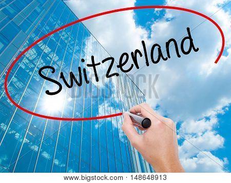 Man Hand Writing Switzerland  With Black Marker On Visual Screen