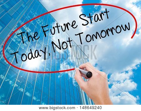Man Hand Writing The Future Start Today, Not Tomorrow With Black Marker On Visual Screen.