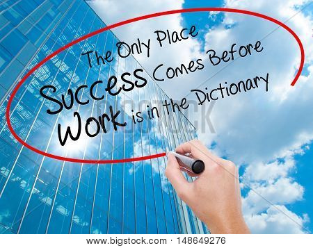 Man Hand Writing The Only Place Success Comes Before Work Is In The Dictionary With Black Marker On