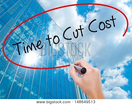 Man Hand Writing Time To Cut Cost With Black Marker On Visual Screen