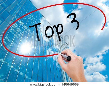 Man Hand Writing Top 3 With Black Marker On Visual Screen