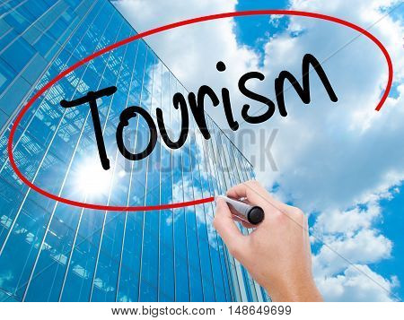Man Hand Writing Tourism With Black Marker On Visual Screen.