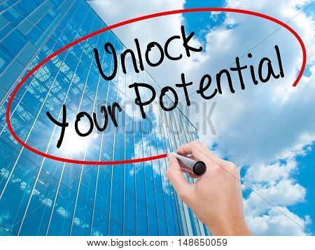 Man Hand Writing Unlock Your Potential With Black Marker On Visual Screen