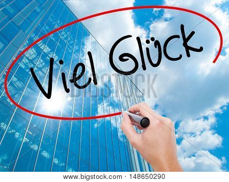 Man Hand Writing Viel Gluck (good Luck In German) With Black Marker On Visual Screen