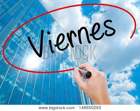 Man Hand Writing Viernes (friday In Spanish) With Black Marker On Visual Screen