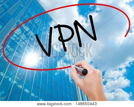 Man Hand Writing Vpn (virtual Private Network) With Black Marker On Visual Screen