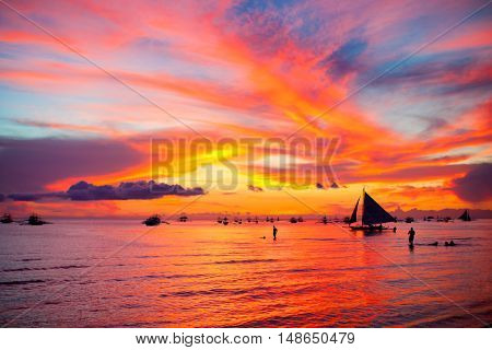 Sailing boat to the sunset in Boracay island on Philippines